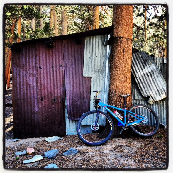 Old School cabin that you pass by just before for starting a steep, hike-a-bike grade to the summit of the ride