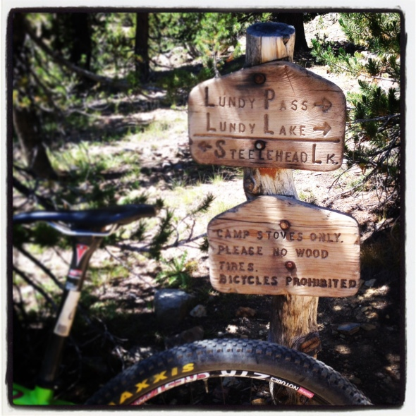 The first trail sign you come across marking the route to Lundy Lake.  Do not take this!  No bikes allowed.